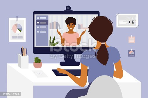 istock Young woman making video call through computer 1255922590