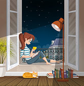 Young woman reading book in the window at night. Drinking tea and reading in the city.