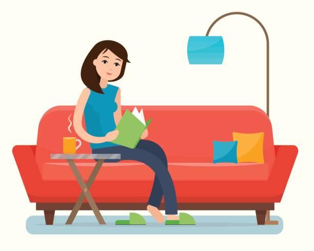 stockillustraties, clipart, cartoons en iconen met jonge vrouw lezen boek op de bank thuis. - woman home magazine