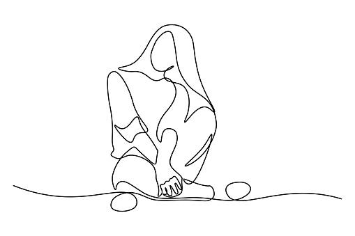 Young woman sitting cross-legged