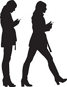 Vector illustrations of a woman standing and walking with her smart phone.