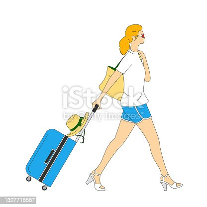 Young woman with suitcase and handbag