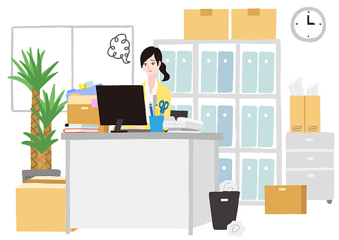 A young woman working in a cluttered office