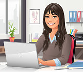 Vector illustration of a young woman with long hair sitting in an office or appartment at a desk, working on a laptop. Concept for young people, businesspeople, place of work, working at home, office, home office and freelance work.