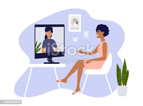 istock Young women making video call through computer 1262945042