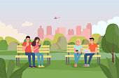 Young women, men sitting on benches and look at gadgets in the park. Vector flat style illustration