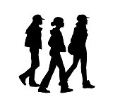 Three young african american women in silhouettes walking together