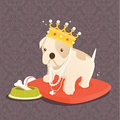 Our pampered pets. A bulldog puppy wearing a crown and various jewelry, sitting on a red velvet pillow, feasting on a bone contained in a food bowl made with pearls and jewels. A grayish purple damask pattern is used in the background.