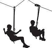 Vector silhouettes of a girl riding on a zip line.