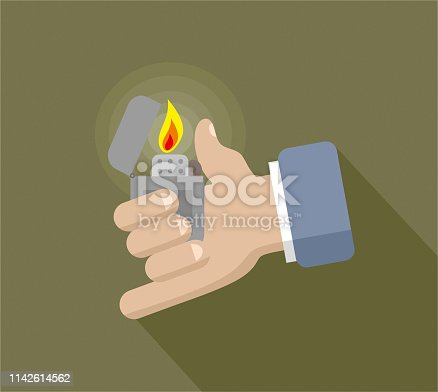 istock Zippo lighter and hand 1142614562