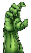 A cartoon green zombie Halloween monster claw hand