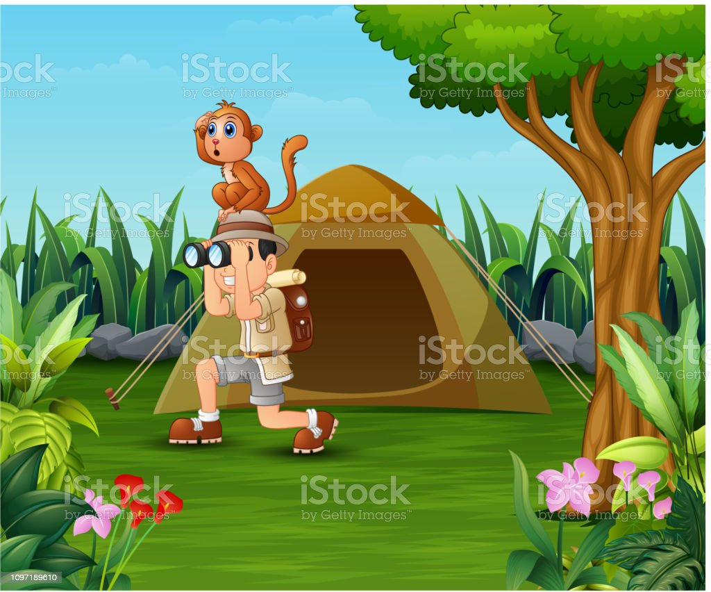 Zookeeper boy and his monkey camping in the beautiful park