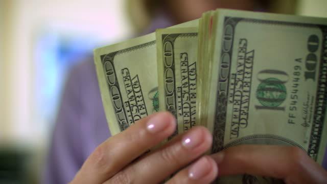 MONEY-$100 BILLS IN HAND-1080HD video