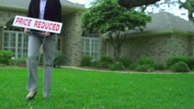 mortgage sign-house price reduced-1080hd - foreclosure stock videos & royalty-free footage