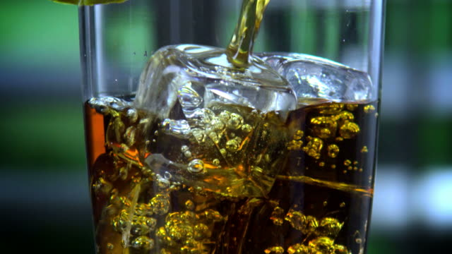ROTATING GLASS FILLED WITH ICED TEA-1080HD video