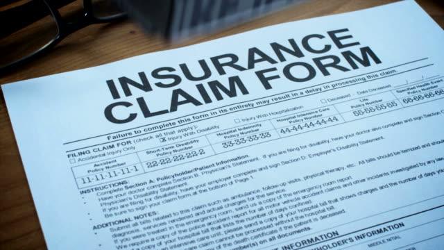 insurance claim form-1080hd - försäkring bildbanksvideor och videomaterial från bakom kulisserna