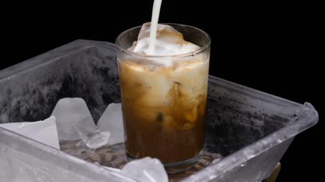 vídeos de stock e filmes b-roll de iced coffee latte - coffee table