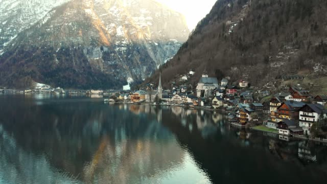 A HIDDEN GEM LIES UNDER THE DACHSTEIN MOUNTAINS - HALLSTATT VILLAGE video