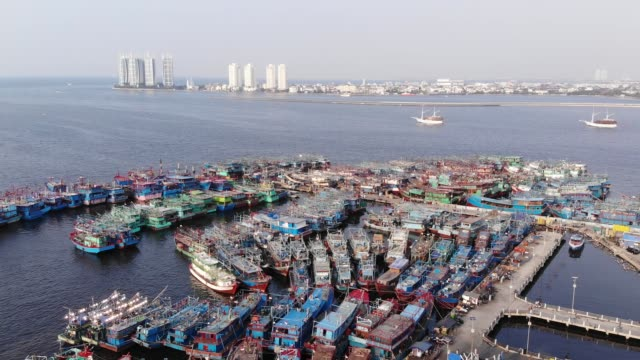 AERIAL FOOTAGE OF MUARA ANGKE PORT Muara Angke Harbor is well known as a place where fishes and other sea foods are distributed to Jakarta jakarta stock videos & royalty-free footage