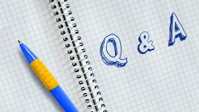 Q & A Text Q & A handwritten on sheet of notebook and animated. faq stock videos & royalty-free footage