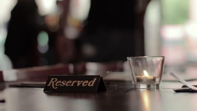 restaurant reservation - fare una prenotazione video stock e b–roll