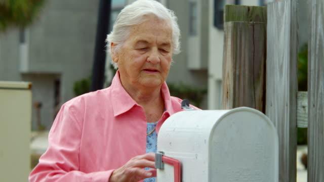 ELDERLY WOMAN CHECKING MAILBOX video