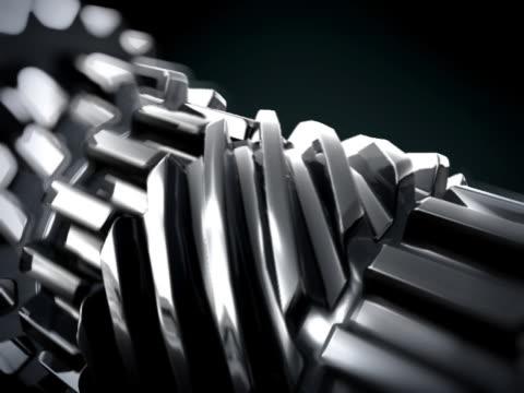 CLOSE UP IN 3D METTALIC GEARS ROTATING LOOP video