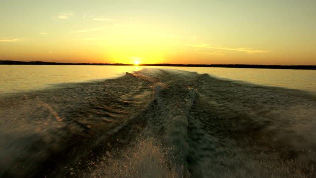 BOAT WAKE AT SUNSET video