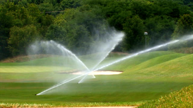 SPRINKLERS ON A GOLF COURSE video