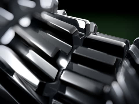 CLOSE UP IN 3D METTALIC GEARS ROTATING video
