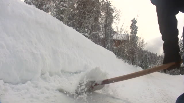 HD 1080i Man Shoveling Snow 4 video