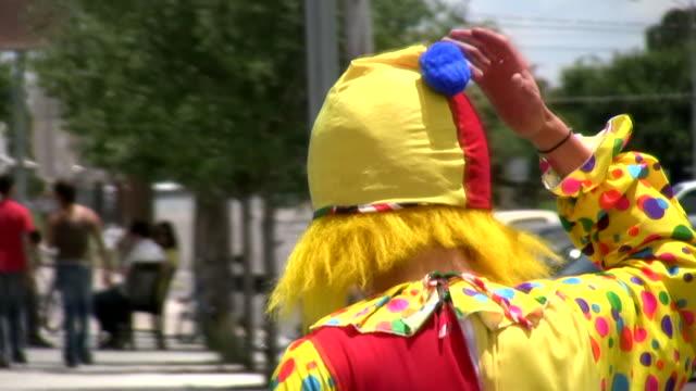HD 1080i Sad Clown walking away in slow-mo video