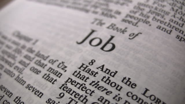 HD 1080i The Book of Job Closeup of the book of Job in Holy Bible. old testament stock videos & royalty-free footage
