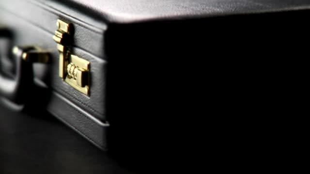 hd 1080p - series of briefcase close-ups - läder bildbanksvideor och videomaterial från bakom kulisserna