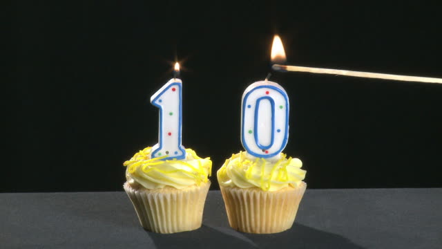 10th anniversary written with lit candles which are blown out video