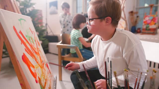 10-year-old child with Down syndrome is gifted with talents. He talks, paints.