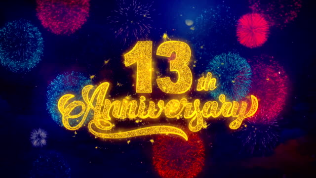 13th happy anniversary greeting text sparkle particles on colored fireworks - anniversario video stock e b–roll
