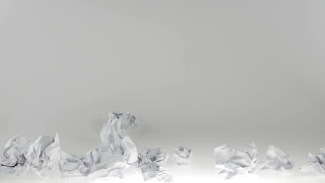 180fps Super Slow Motion Crumpled Papers Falling on White Background video