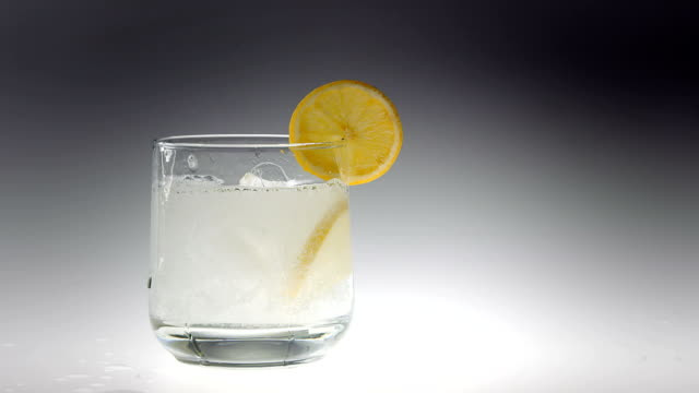 180fps Super Slow Motion Ice Cubes Falling into Drink 180fps Super Slow Motion Ice Cubes Falling into Drink tonic water stock videos & royalty-free footage