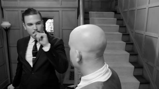 1950s styled men meet at bottom of stairs in film noir setting video