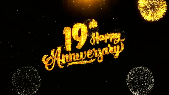 19th happy anniversary text greeting and wishes card made from glitter particles from golden firework display on black night motion background. for celebration, party, greeting card, invitation card. - anniversario video stock e b–roll