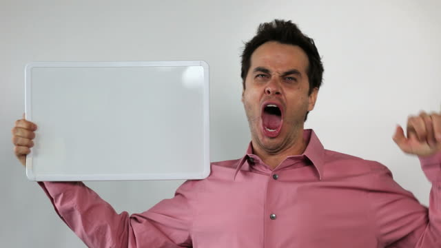 1.\tCharismatic Sales Guy Holding White Board, Rock ON! video
