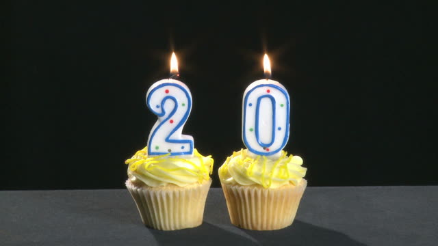 20th anniversary written with lit candles which are blown out video