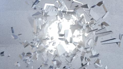 3d-rendering, explosion, betonwand, rissige erde, einschussloch, zerstörung, abstrakten hintergrund mit volumen lichtstrahlen gebrochen - computergrafiken stock-videos und b-roll-filmmaterial