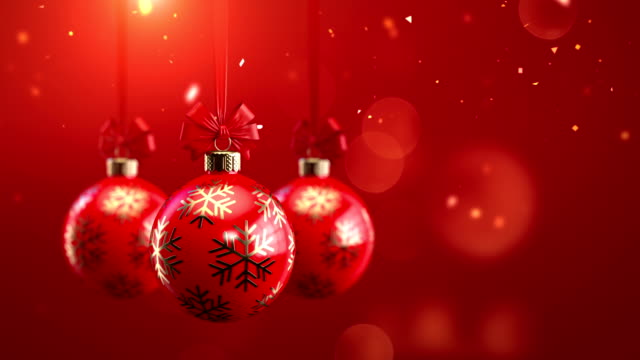 3d rendering Three red decorated christmas balls with bows on sparkling background seamlessly loop-able animation