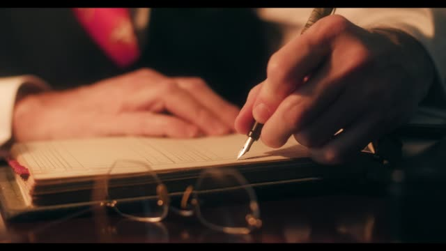 40s businessman using a fountain pen writing in the company ledger 1940s period piece of businessman hands using a classic fountain pen to make entries into a company ledger. 20th century stock videos & royalty-free footage