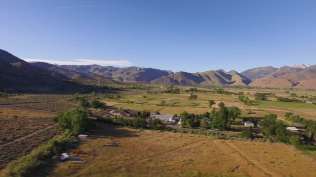 4k 1 mile long aerial of an expansive valley in the Sierra Nevada Mountain range. video