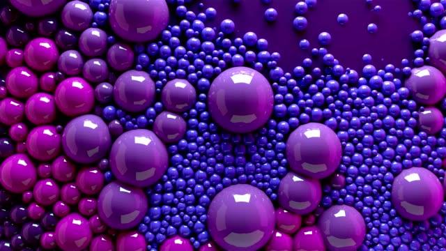 4k 3d animation von kugeln und kugeln bunten regenbogen in einem organischen bewegung hintergrund. top-ansicht von blasen bunte farbe - kugelform stock-videos und b-roll-filmmaterial
