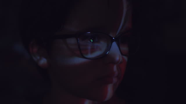 4k Abstract Shot of a Child Face with Projector Reflection of Explosion video