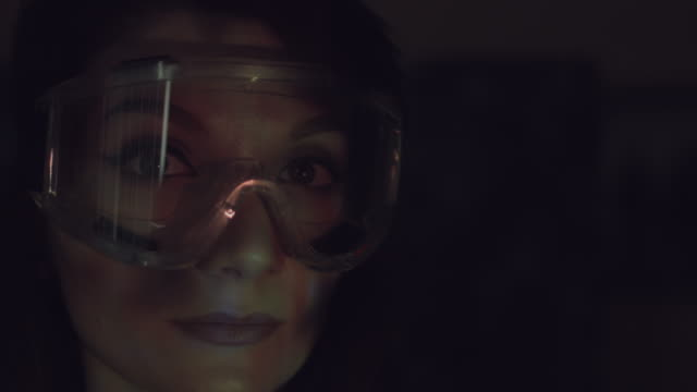 4k Abstract Shot of a Woman Face and Glasses with Projector Reflection of Fire video